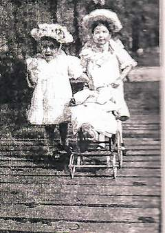 Here's Ernest Hemingway walking with his sister. Can you tell who is who?